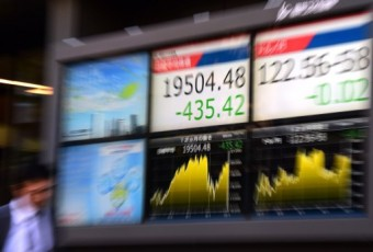 Tokyo shares up on US tax, Japan easing talk