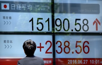Tokyo stocks close at fresh two-decade highs